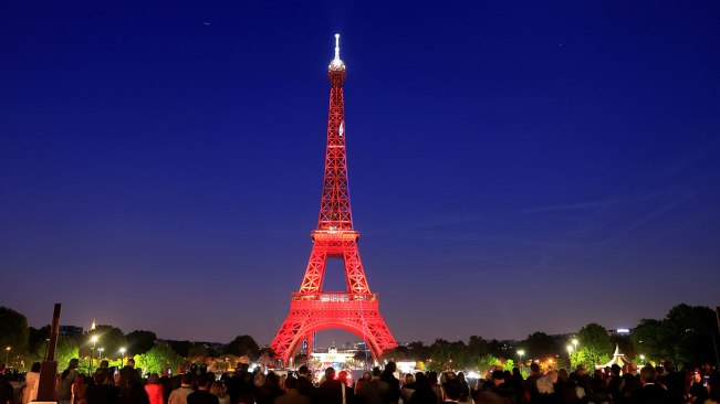 The Eiffel tower is illuminated during a light show to celebrate its 130th anniversary in Paris